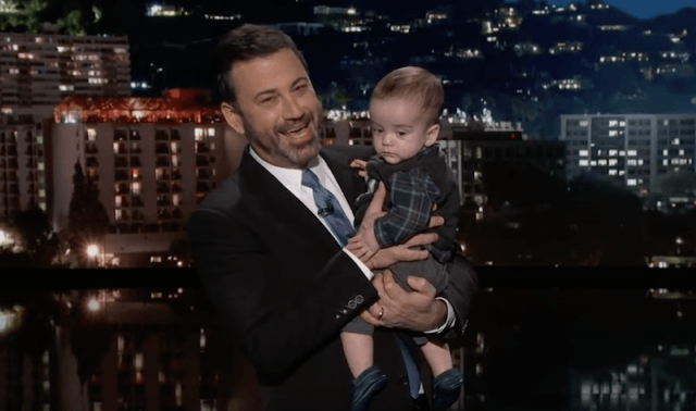 Jimmy Kimmel holding his baby.