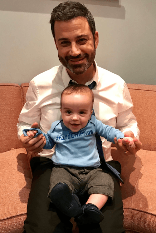 Jimmy Kimmel holding his son.