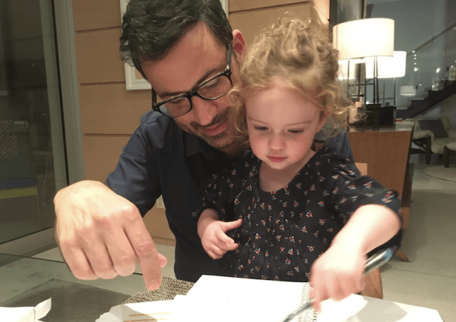 Jimmy Kimmel and his daughter look at a notebook.
