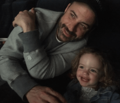 Jimmy Kimmel and his daughter watching a movie.