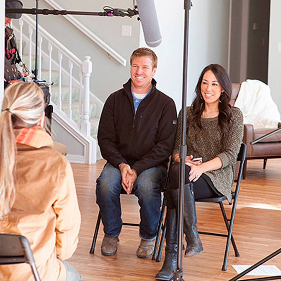 Chip and Joanna Gaines being interviewed