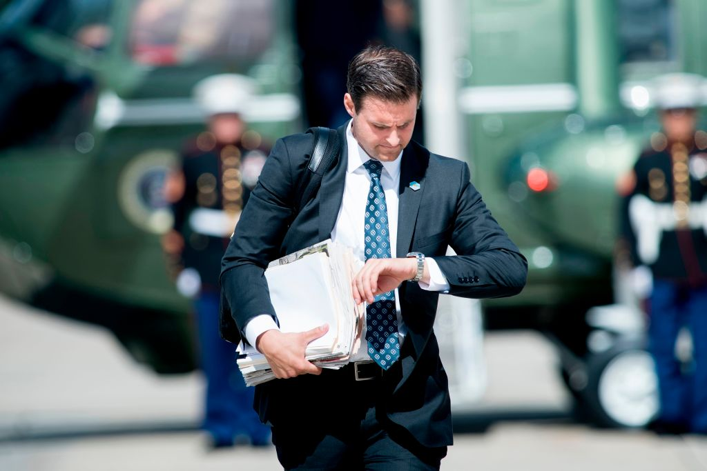 John McEntee, special assistant and personal aide follows US President Donald Trump to Air Force One