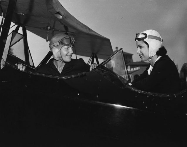 June Travis, the Warner Brothers starlet, taking flying lessons for her film 'Ceiling Zero', from Amelia Earhart