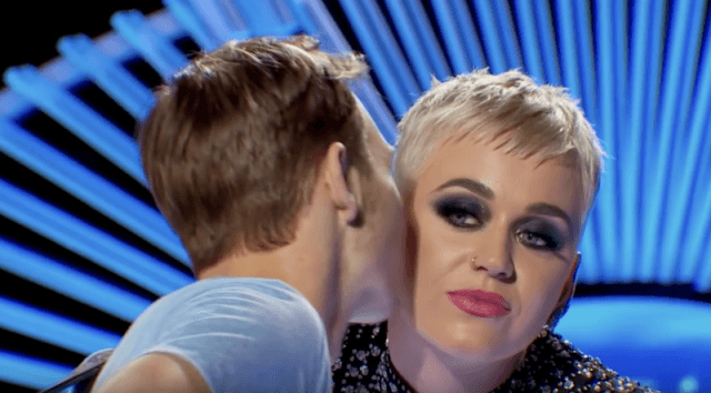 Katy Perry being kissed by Benjamin Glaze.