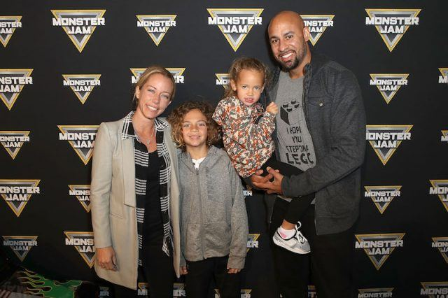 Kendra smiles on a red carpet with her family.