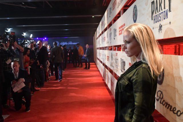 Kendra posing on a red carpet.