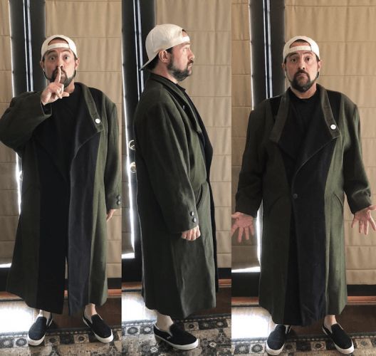 Kevin Smith's photos of himself in a long green coat.