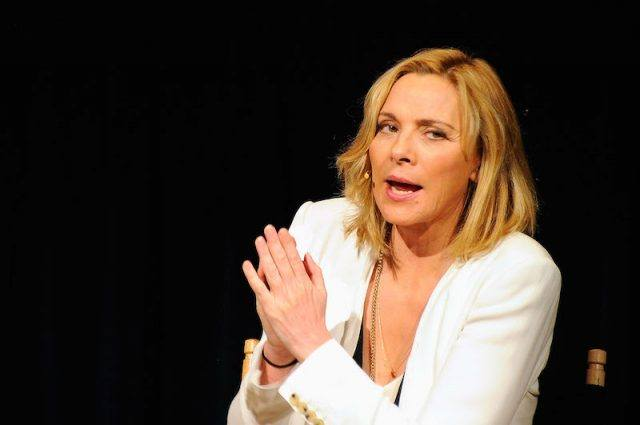 Kim Cattrall wearing a white suit.