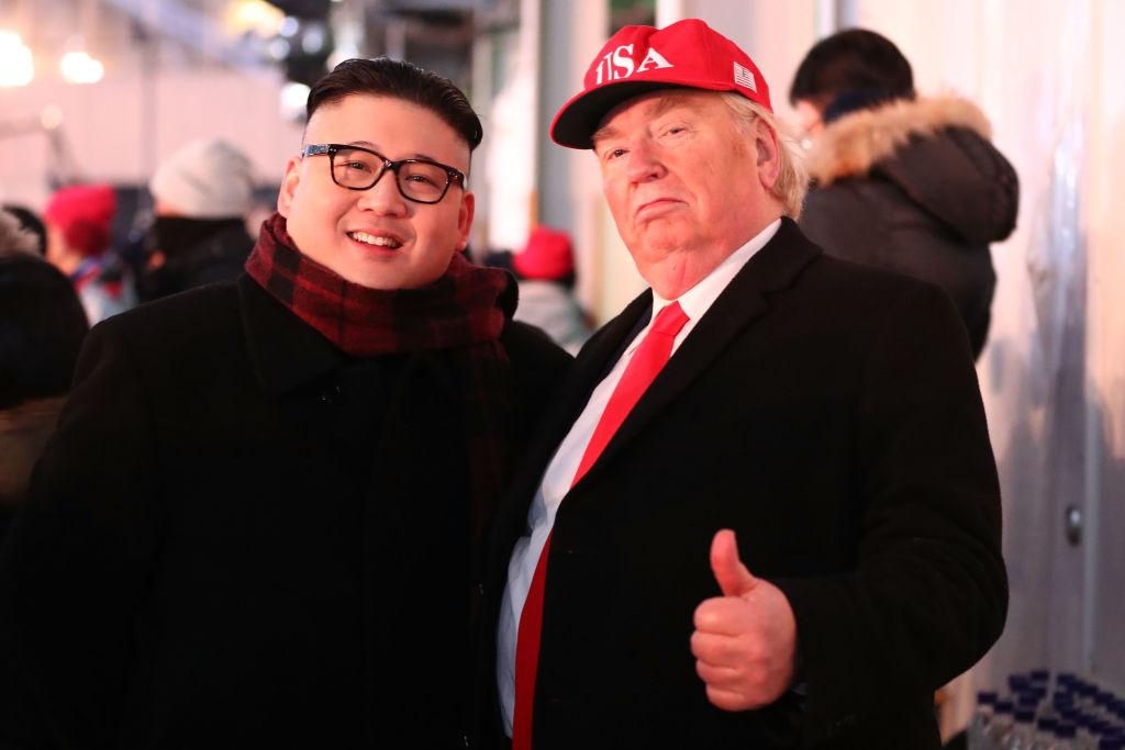 Kim Jong Un poses with Donald Trump