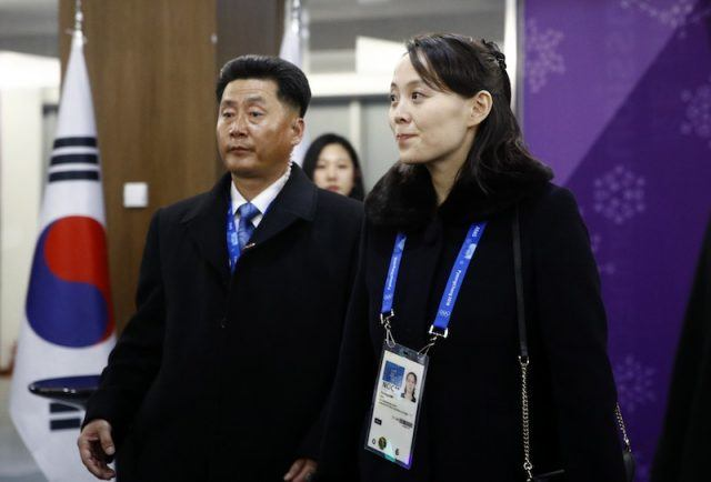 Kim Yo Jong wearing a lanyard with her photo on it during the Olympic Games.