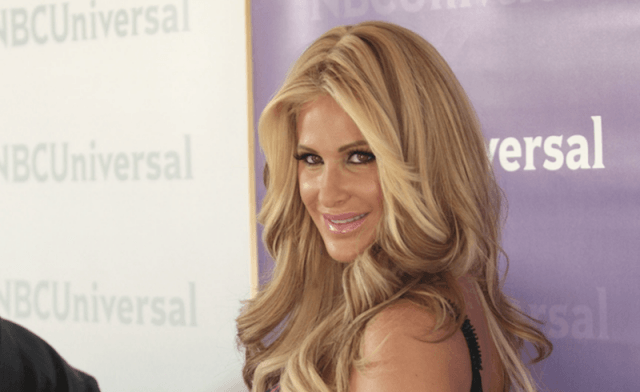 Kim Zolciak Biermann posing on a red carpet.