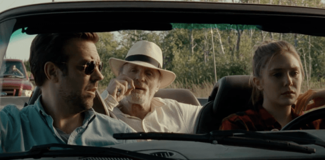 Three characters ride in a car together.