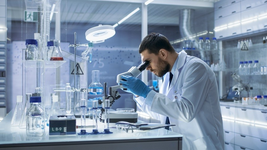 Research Scientist Looks into Microscope