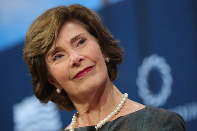 Laura Bush smiling while on stage.