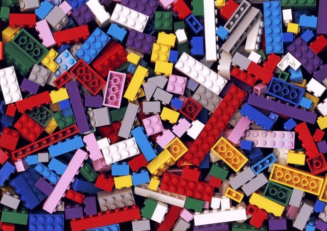 Lots of colorful Lego blocks on the ground.