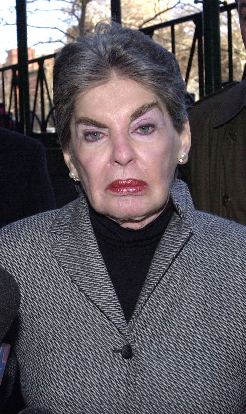 Real estate mogul Leona Helmsley is aided by her body guards as she arrives to court