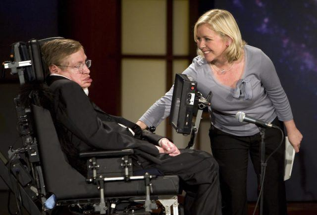 Lucy Hawking reaching of her father during a presentation.