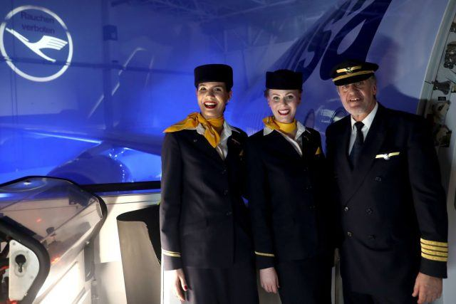 Airhostesses and a pilot of German airline Lufthansa