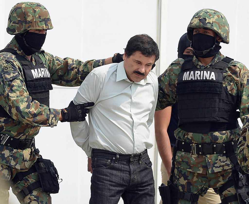 "Mexican drug trafficker Joaquin Guzman Loera aka ""el Chapo Guzman"" is escorted by marines as he is presented to the press"