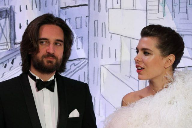 Charlotte Casiraghi and her partner Dimitri Rassam pose upon their arrival for the annual Rose Ball at the Monte-Carlo Sporting Club