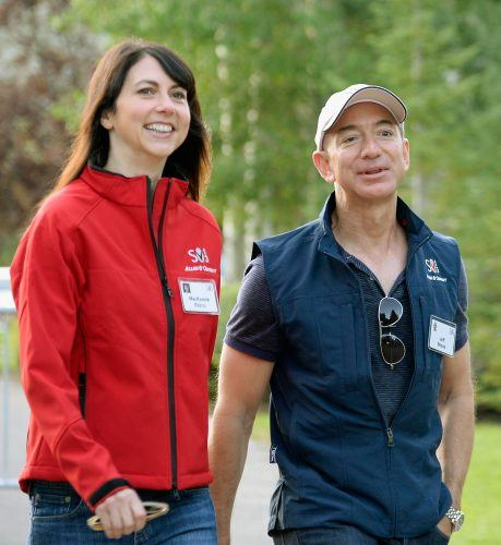 Jeff Bezos and his wife walking outdoors.