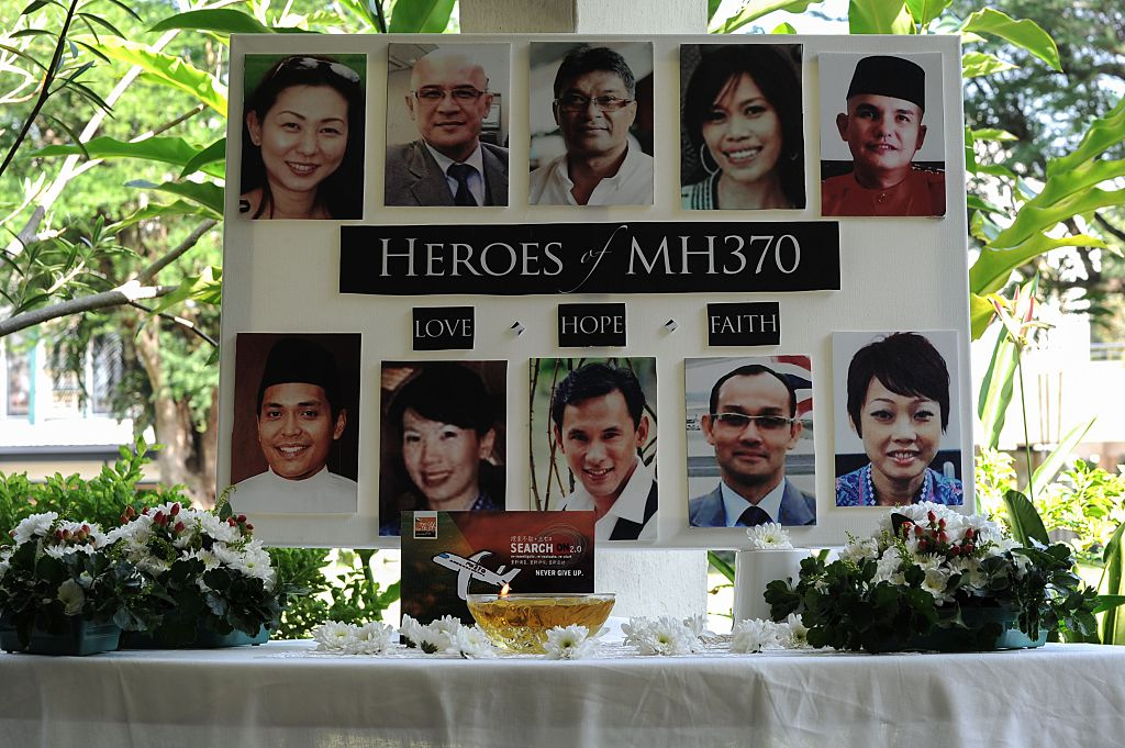 A poster showing cabin crew from missing Malaysia Airlines flight