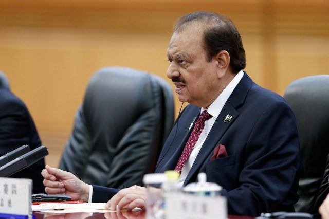 Pakistan President Mamnoon speaking in a courtroom.