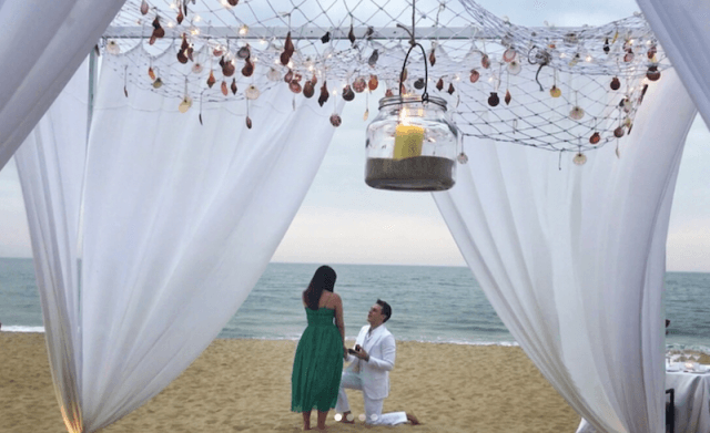 Louis Ducret proposing to Marie Chevallier on a beach.