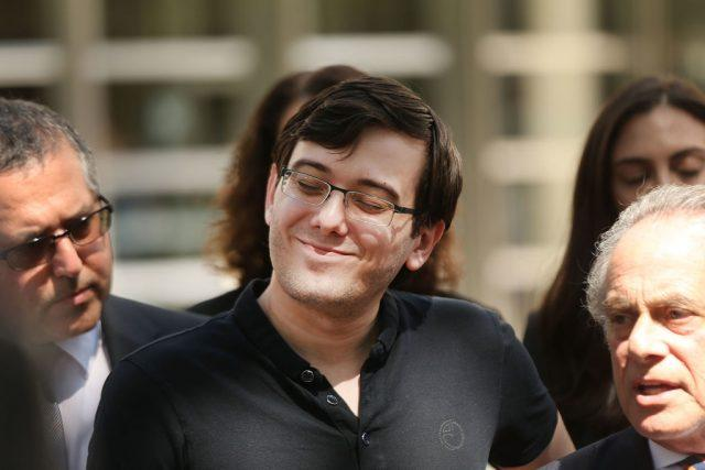 Former pharmaceutical executive Martin Shkreli smiles while speaking to the media in front of U.S. District Court