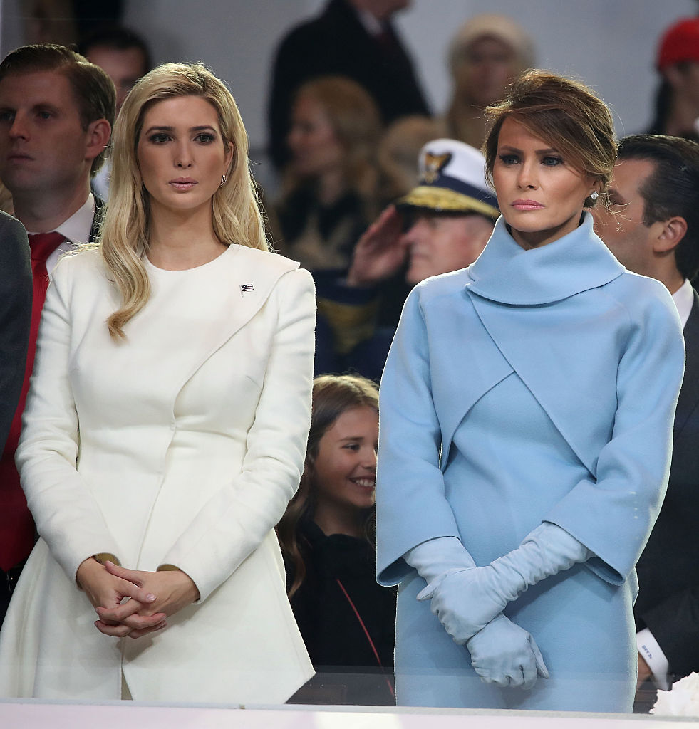 Melania Trump (R), stands with Ivanka Trump