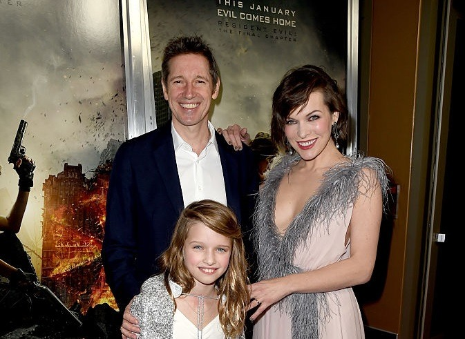 Paul W.S. Anderson, Milla Jovovich, and their daughter