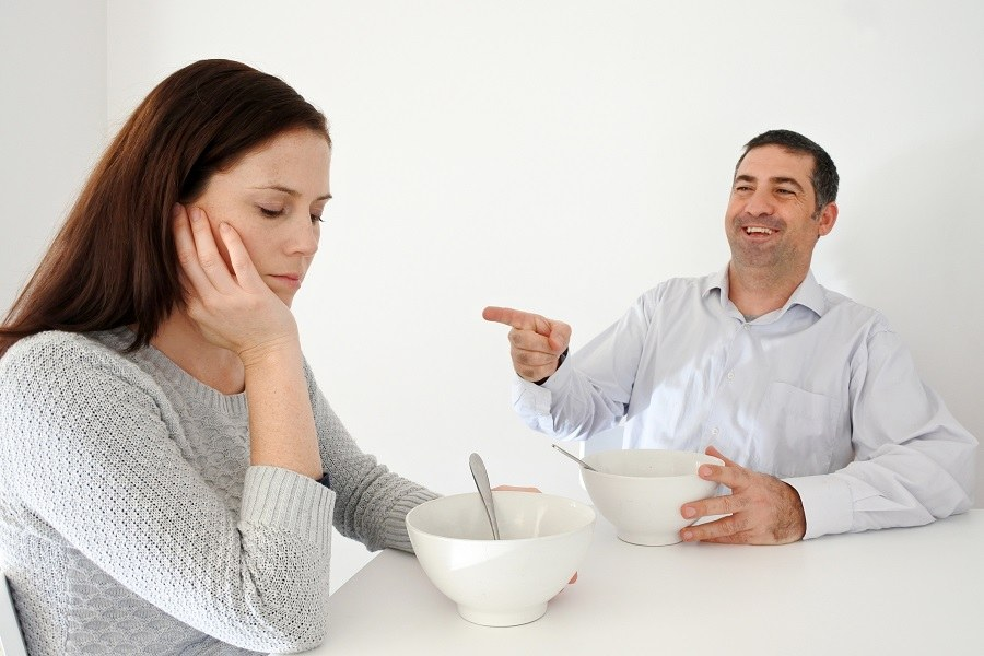 Husband teasing wife