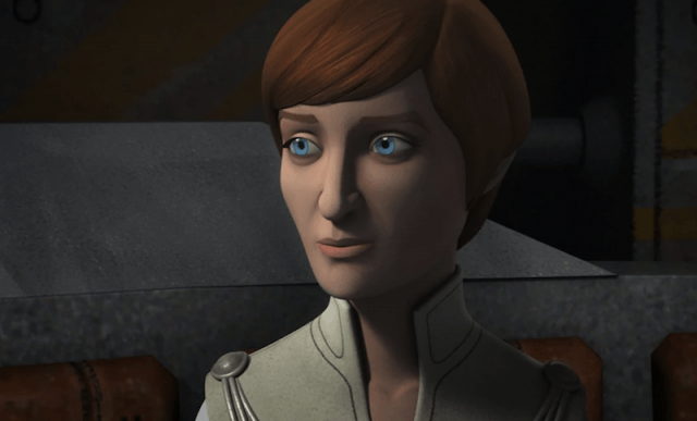 Mon Mothma staring straight ahead while inside a dark room.