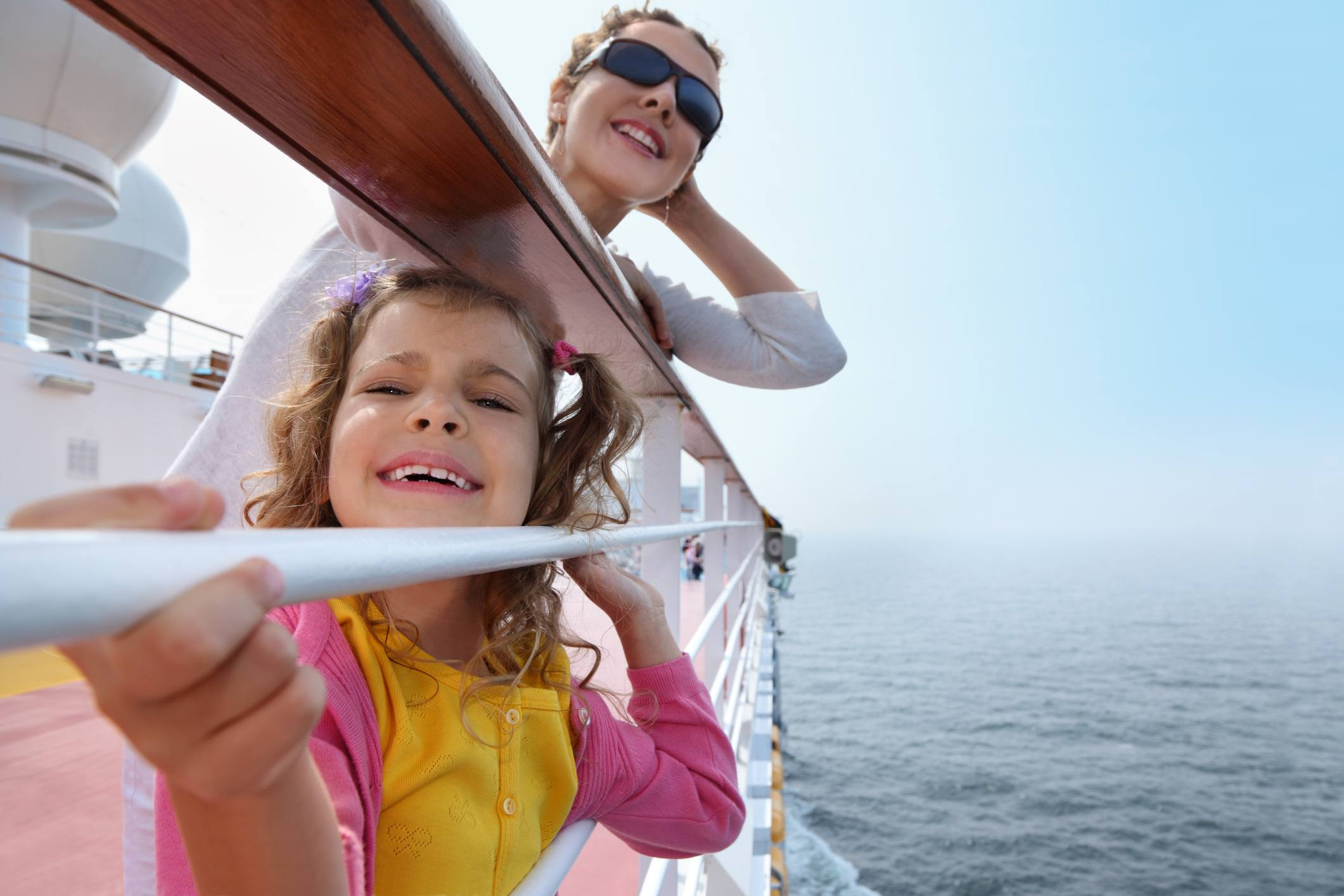 Mother and daughter traveling on cruise ship
