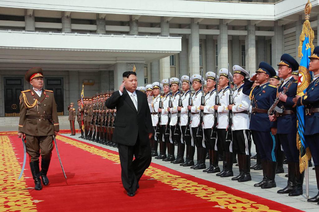 Kim Jong Un with guards
