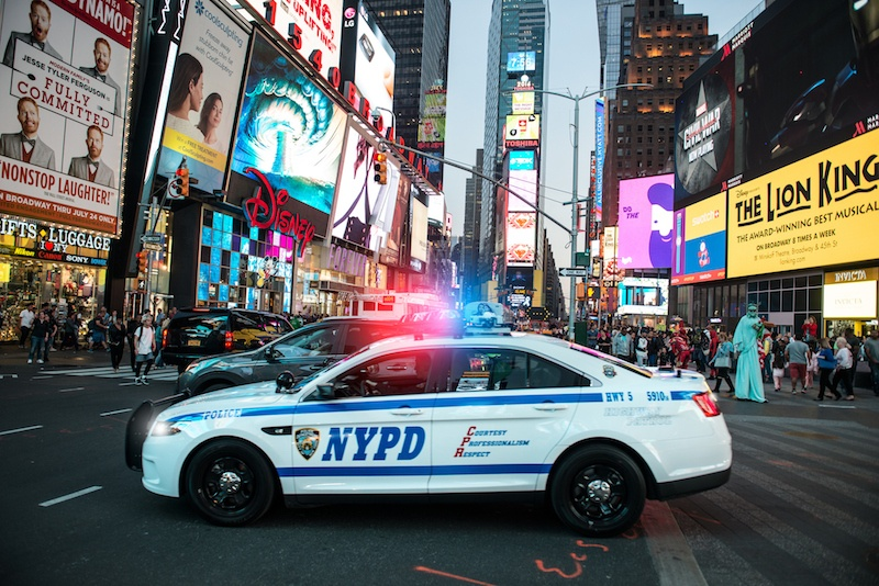 NYPD police squad car goes to emergency call with alarm