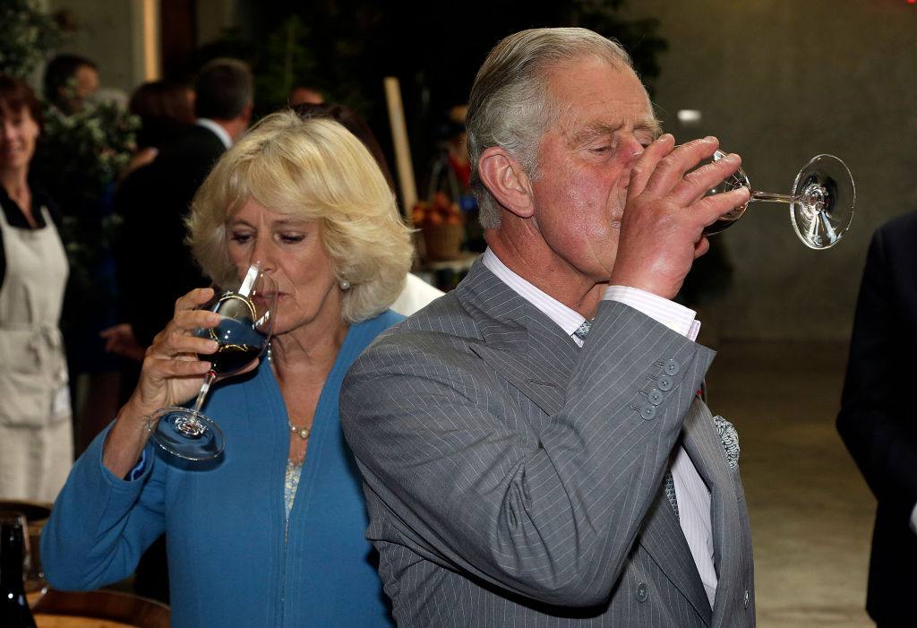 Britain's Prince Charles and his wife Camilla, Duchess of Cornwall taste local wine
