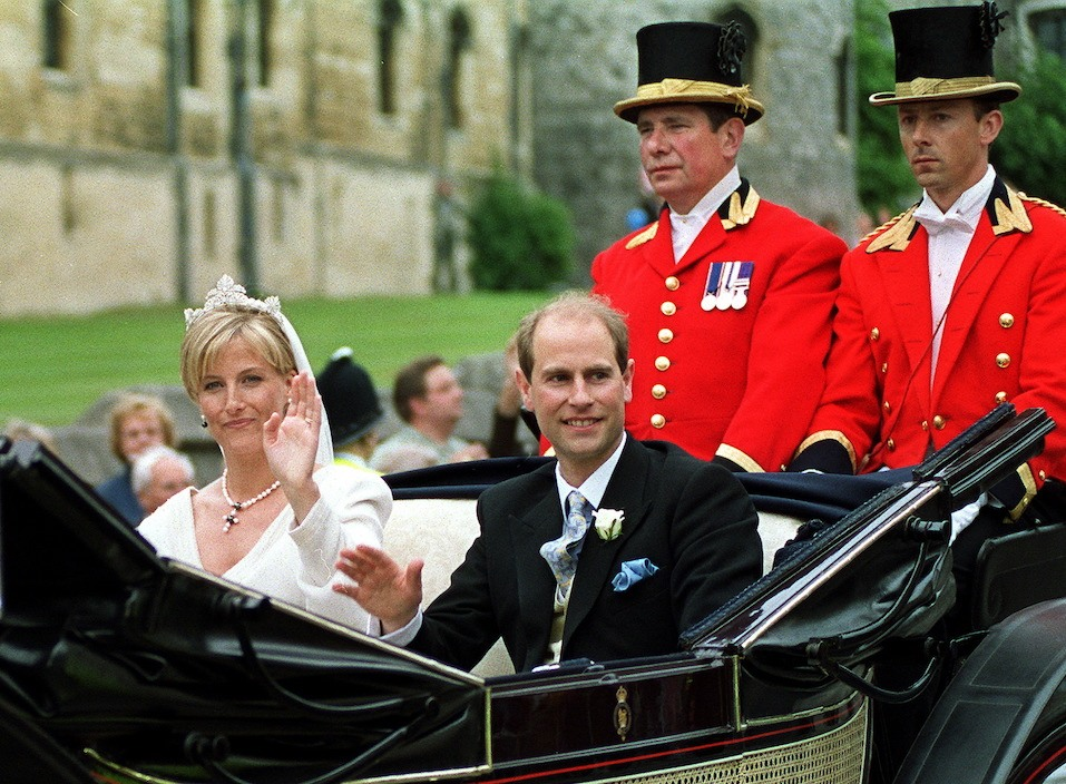 Newly-wed British royal couple Prince Edward and Sophie Rhys-Jones wave to wellwishers as their carriage leaves Windsor Castle