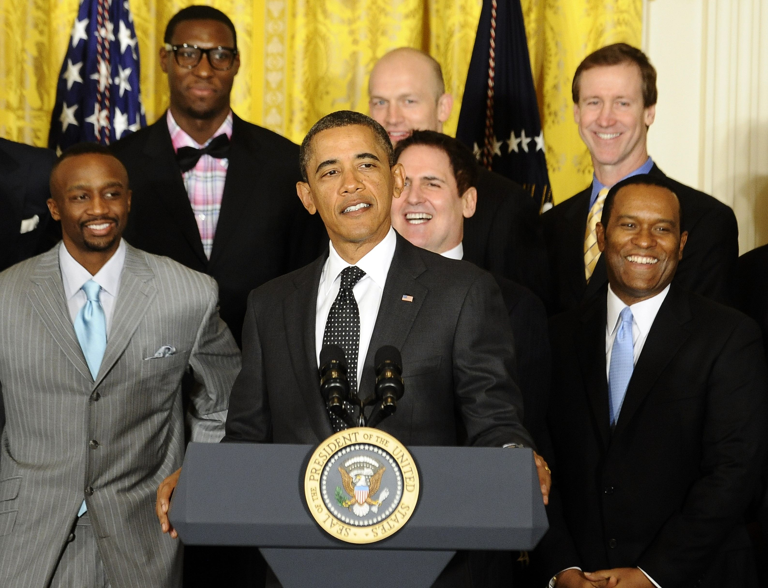 US President Barack Obama (C) speaks during Dallas Mavericks championship event