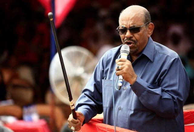 Sudanese President Omar al-Bashir delivers a speech during a visit to the village of Bilel in South Darfur.