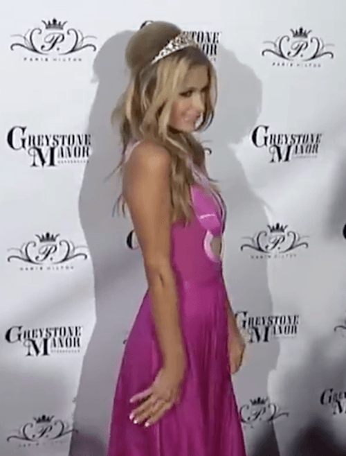 Paris Hilton posing on a red carpet.