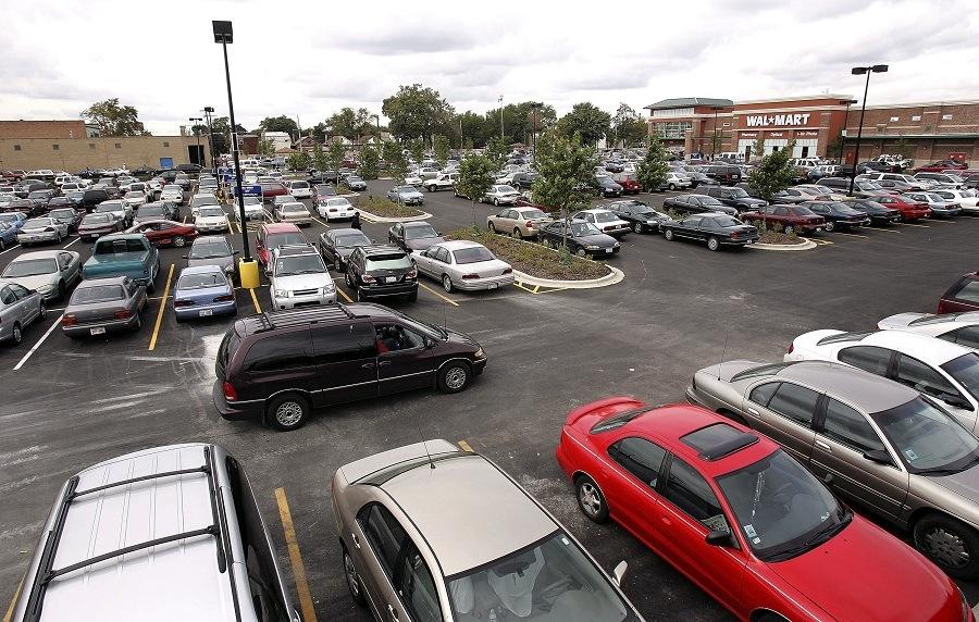 A car drives through the parking lot