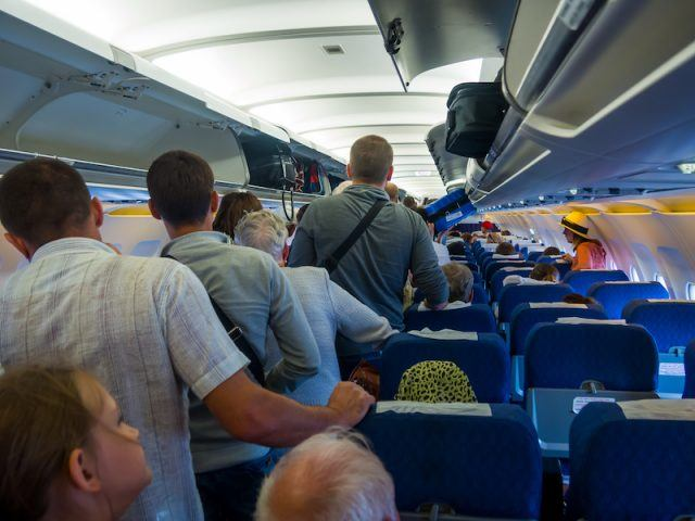 Passengers departing from a plane.
