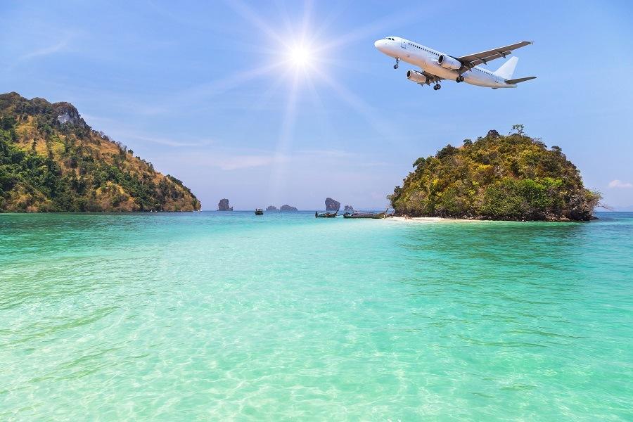 passenger airplane landing above small island
