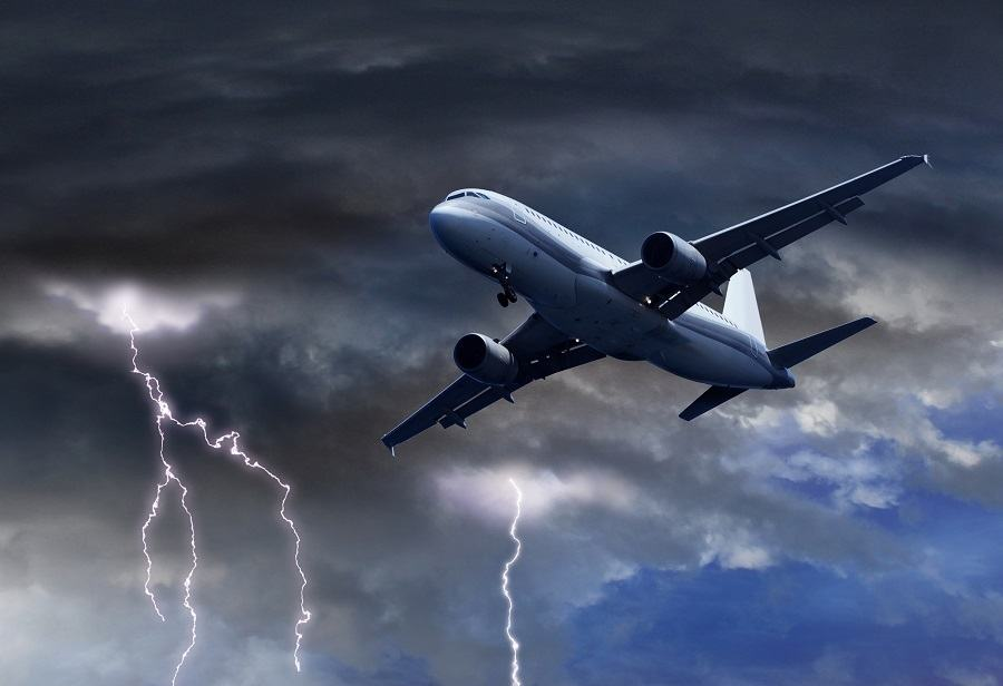 Passenger air plane approaching turbulent thunder storm lightning
