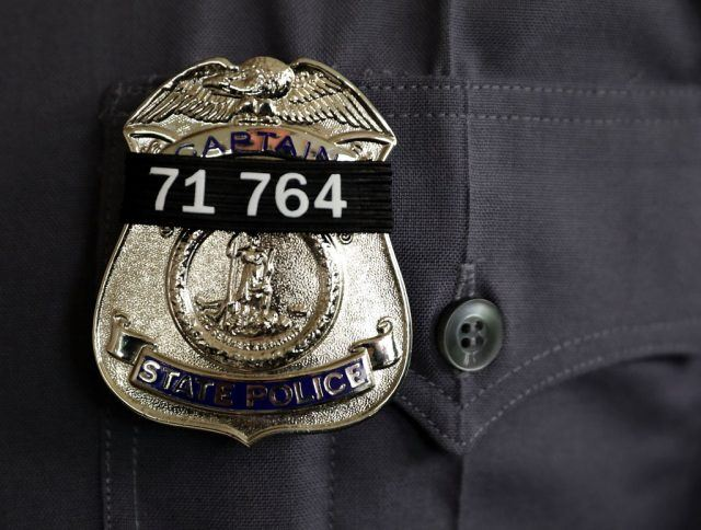 A black band with the badge number of Virginia State Police
