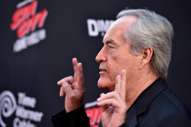 Powers Boothe posing on a red carpet.