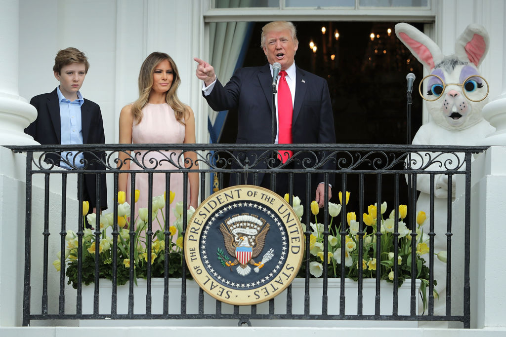 U.S. President Donald Trump delivers remarks from the Truman Balcony with first lady Melania Trump and their son Barron Trump on the South Lawn of the White House