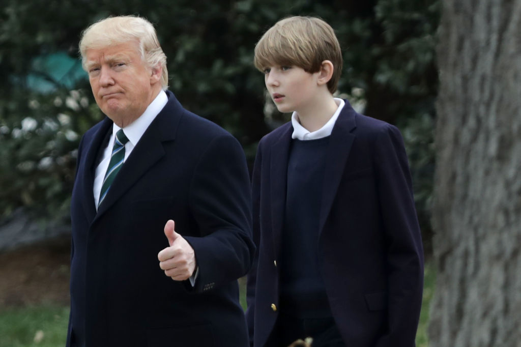U.S. President Donald Trump and his son Barron Trump depart the White House