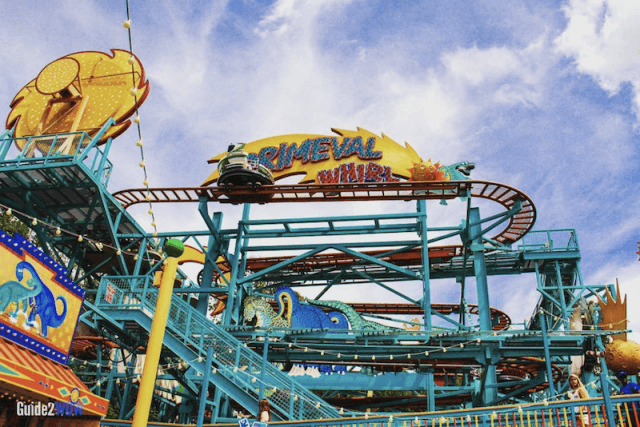 A roller coaster on a blue day.